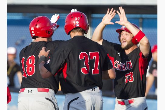 Canada powers past Puerto Rico to clinch top spot